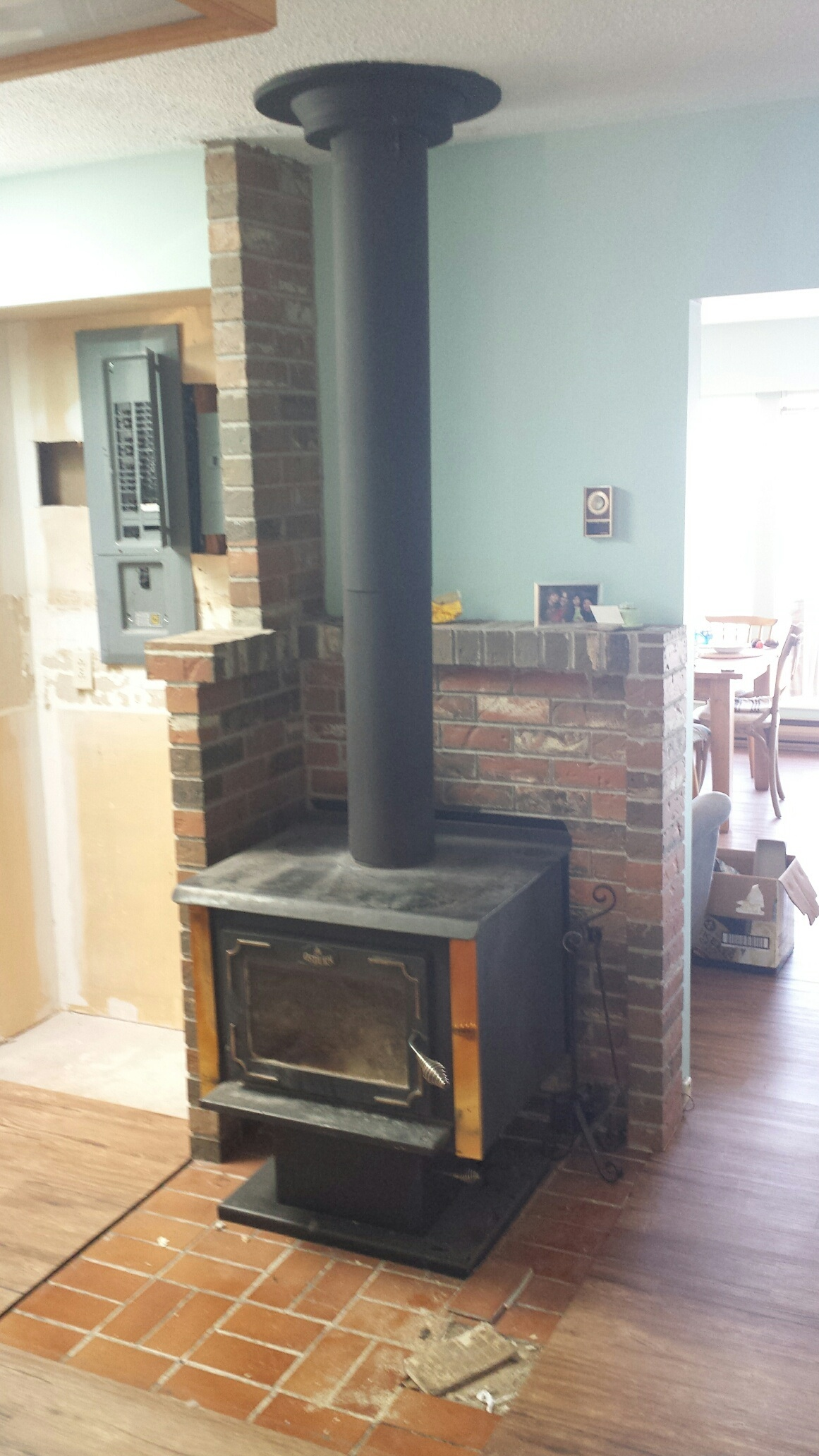 Wood stove heat shield reduces clearances by 66%