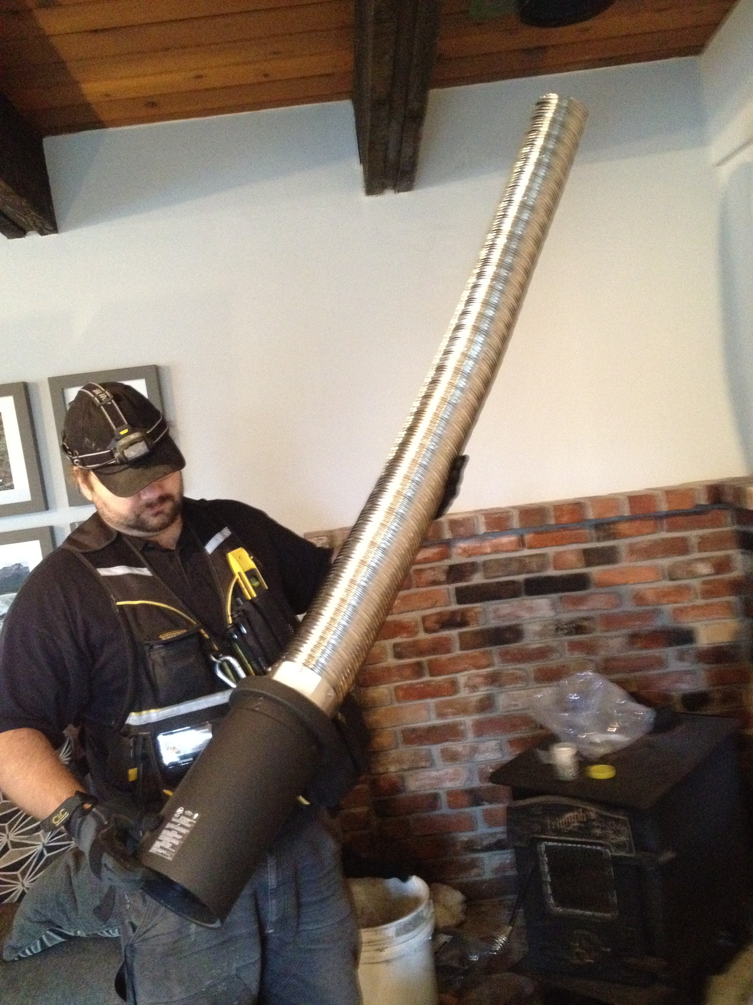 Fitting a piece of liner chimney liner victoria BC